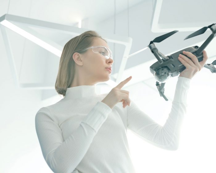 woman-with-modern-drone-G8NRETR.jpg